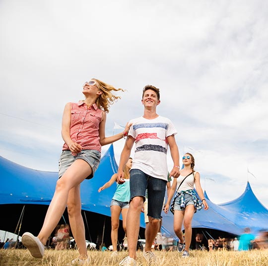 teenagers-at-summer-music-festival-in-front-of-PSUEN3F.jpg